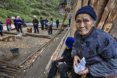 An elderly Chinese woman farmer Miao, at the village celebration Stock Photo