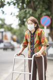 Elderly chinese woman wearing mask for protect air pollution Stock Photography