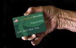 Elderly citizens can receive federal benefits in the form of a debit card. Federal benefits for Social Security, SSI, VA and stock photography