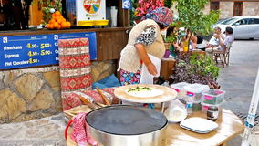 The elderly cook. ANTALYA, TURKEY - MAY 6, 2017: The elderly cook prepares gozleme, traditional flatbread with different toppings - cheese, potato, butter and stock video footage