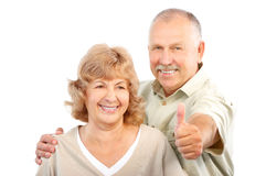 Elderly couple. Happy elderly couple in love. Isolated over white background stock images