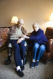 Elderly couple. Elderly Caucasian couple in bedroom at retirement community center stock photography