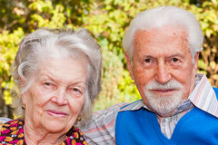 Elderly couple. Portrait of an elderly couple sitting outdoors Stock Image