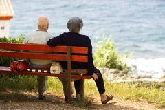 Elderly couple. Are resting on the bench stock photos