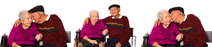 Elderly couple. Elderly married couple with an affectionate pose on a white background Royalty Free Stock Image