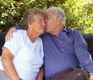 Elderly couple,. Couple of old swingers having a cuddle Stock Photography