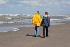 Elderly couple. Couple walking along the sea royalty free stock photos