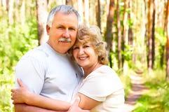 Elderly couple. Smiling happy elderly couple in love outdoor royalty free stock photo