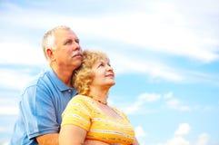 Elderly couple. Smiling happy elderly couple in love outdoor royalty free stock photos