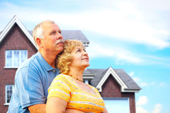 Elderly couple. Near their home.  Real estate and insurance concept Stock Image