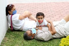Free Elderly Couple And 2-year-old Latina Girl With Protective Face Masks, New Normal Covid-19 Stock Photos - 193785473