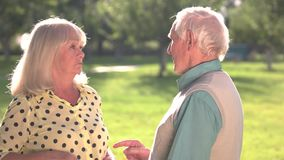 Elderly couple arguing. Woman pointing finger at man. You are so wrong. Problems that test feelings stock footage