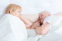 Elderly couple asleep in bed Royalty Free Stock Photo