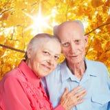 Elderly couple on autumn landscape Stock Photo