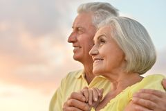 Elderly couple  on the background of sky Stock Photos