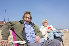 Elderly couple on the beach Stock Photo