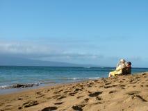 Elderly Couple on the Beach. Elderly couple enjoying afternoon on a beach Stock Photos