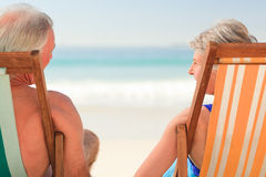 Elderly couple at the beach Stock Image