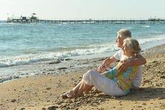 Elderly couple on beach Stock Image