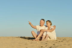 Elderly couple on a beach Stock Photos