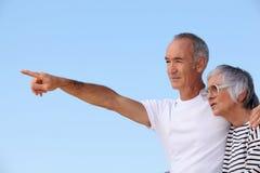 Elderly couple at the beach Stock Photos