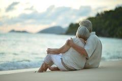 Portrait of elderly couple on a beach. Elderly couple on beach. Travel. back view royalty free stock photos