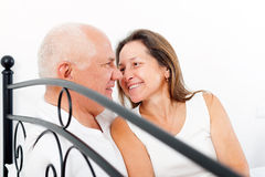 Elderly couple in bed. Stock Images