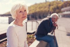 Elderly couple being absorbed into unsettling thoughts Royalty Free Stock Image