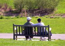Elderly couple on bench 2. Elderly couple sitting on a park bench Stock Photography