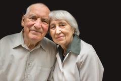The elderly couple on black background Stock Images
