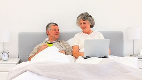 Elderly couple buying something on the net Royalty Free Stock Image