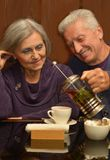 Elderly couple in cafe Royalty Free Stock Photography