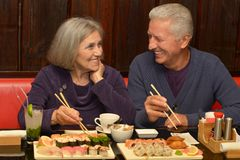 Elderly couple in cafe Stock Photo