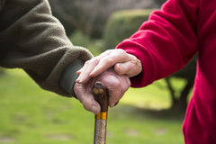 Elderly couple with a cane Royalty Free Stock Photography