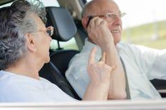 Elderly couple in car. Elderly couple in the car stock photos