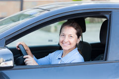 Elderly couple in  car. Stock Images
