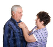 Elderly couple. Caring about each other. Royalty Free Stock Image