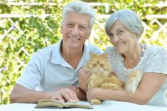Elderly couple with cat Royalty Free Stock Photo