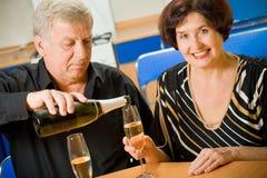 Elderly couple celebrating Royalty Free Stock Photos