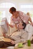 Elderly couple celebrating birthday. Royalty Free Stock Images