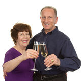 Elderly couple with champagne Royalty Free Stock Photos