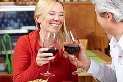 Elderly couple cheering with wine Royalty Free Stock Photography