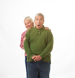 Elderly couple in Christmas colors Stock Photos