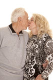 Elderly couple close kiss Stock Images