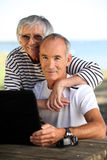 Elderly couple with a computer Stock Photography