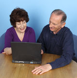 Elderly couple with computer Royalty Free Stock Photos