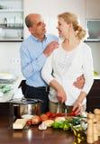 Elderly couple cooking salad Stock Photos