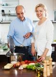 Elderly couple cooking vegetarian soup Stock Photos