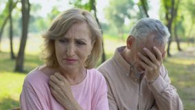 Elderly couple crying, frustrated with illness of close relative, despair stock footage
