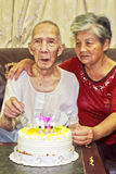 Elderly couple cutting the birthday cake Royalty Free Stock Photo